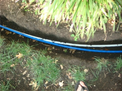 Trenching with PEX water lines for whole house water filter install